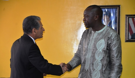 Finance and Development Planning Minister exchange hand shake with United Nations Secretary General of the Special Representative to Liberia