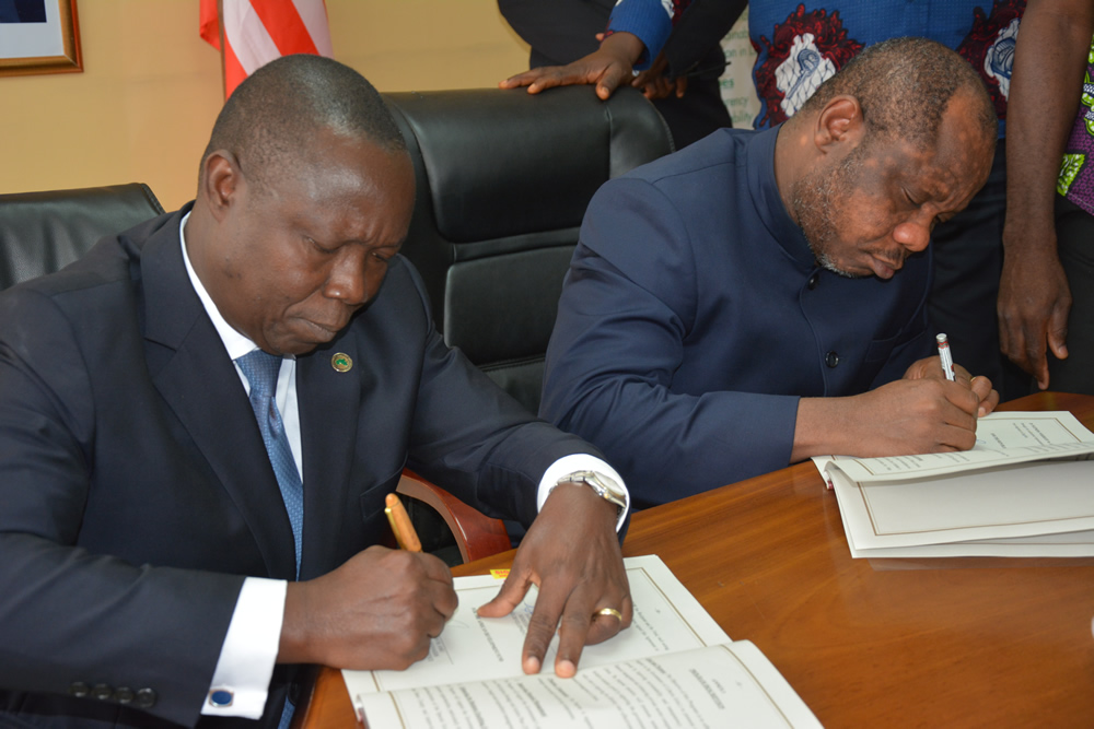 Finance Minister Hon  Samuel D Tweah Jr and Mr  Orison M  Amu.jpg